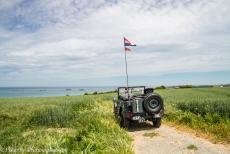 75th anniversary of D-Day - Classic Car Road Trip Normandy, 75 years after D-Day: Our own jeep on a plateau overlooking Gold Beach at Arromanches-les-Bains, the remains...