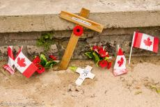 75th anniversary of D-Day - Classic Car Road Trip Normandy, the 75th anniversary of D-Day: A small Remembrance Poppy Cross placed in front of the Canada...