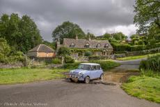 IMM 2019 Bristol - Classic Car Road Trip: In our own Mini Authi driving through the ford on the river Eye in Upper Slaughter. The village is built on both...