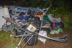IMM 2019 Bristol - Classic Car Road Trip, IMM 2019 Bristol: One of the many piles of destroyed tents, badly torn canvas or other tent material and a tangle of...