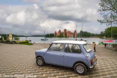 Lithuania 2015 - Classic Car Road Trip: The classic mini in front of Trakai Castle. The castle is located in the Town of Trakai, 28 km west of Vilnius, the...