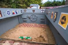 Normandy 2014 - Classic Car Road Trip Normandy: Remembrance crosses with poppies, placed inside an Allied landing craft, the memorials to those...